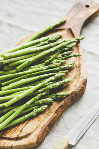 Fresh asparagus on a wooden cutting board Preparation vegetarian healthy food