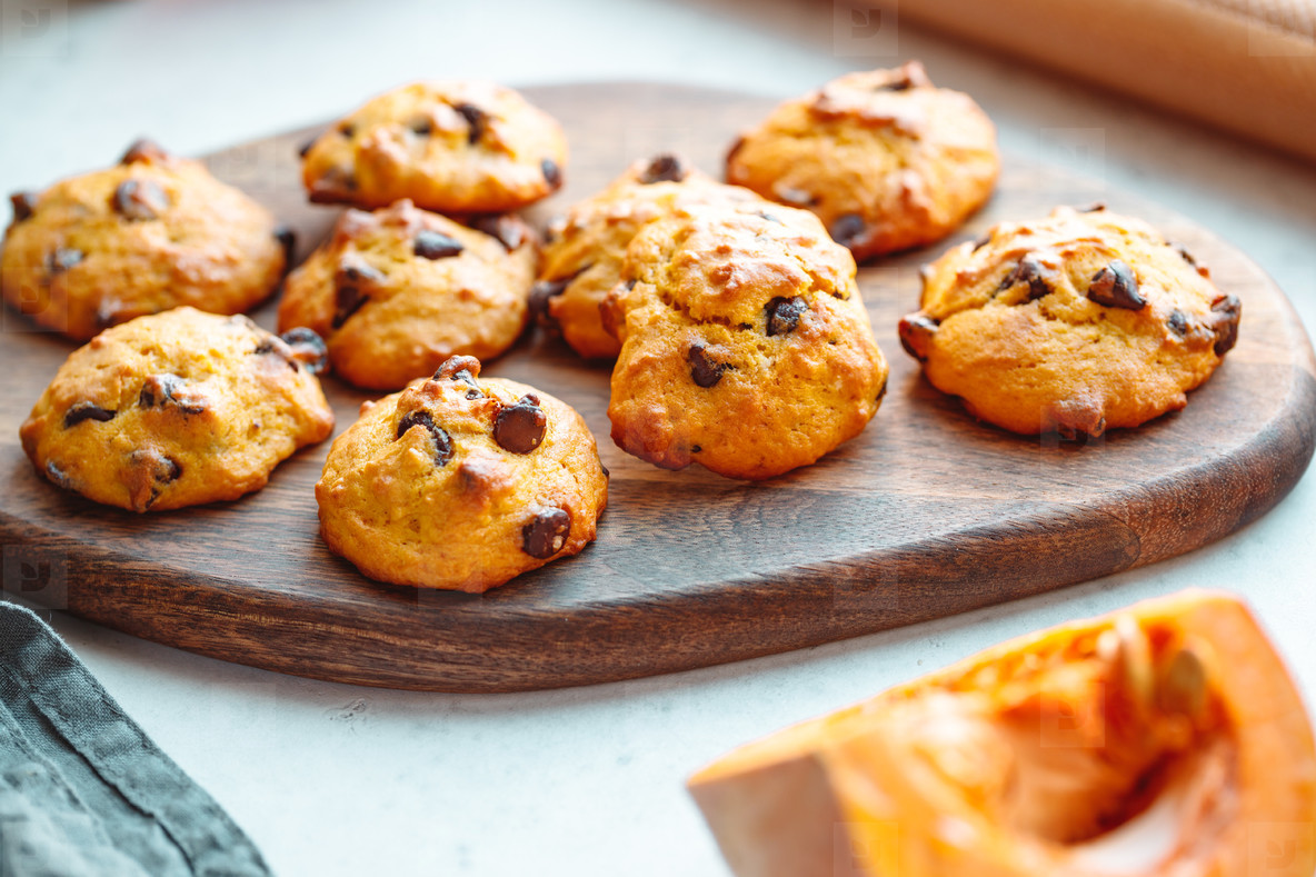 Pumpkin cookies with chocolate chips made from cake mix on a wooden tray
