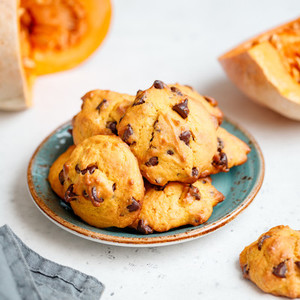 Pumpkin cookies with chocolate chips made from cake mix on a blue ceramic plate