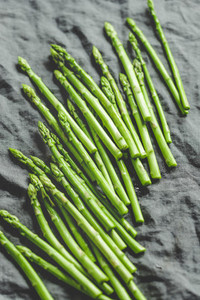 Fresh asparagus on a grey linen kitchen towel  Preparation vegetarian healthy food