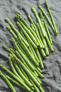 Fresh asparagus on a grey linen kitchen towel Preparation vegetarian healthy food