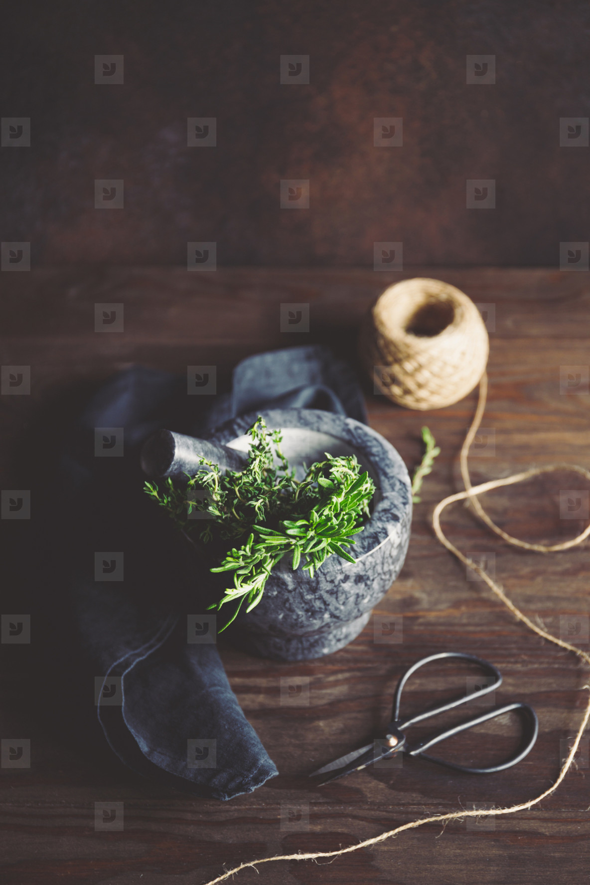 Fresh herbs in a marble mortar on a table  Rustic style food photography  top view