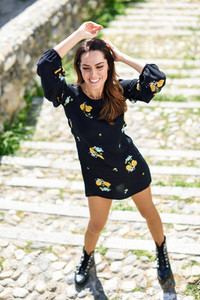 Middle aged woman wearing flowered dress in urban steps