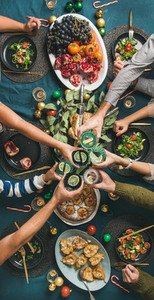 Company of friends or family celebrating Christmas together  vertical composition