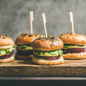 Vegan burgers with beetroot patties and green sprouts  square crop