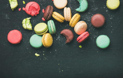 Flat lay of sweet colorful French macaron cookies