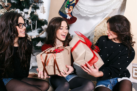 Beautiful girl opening Christmas gifts Decorative vintage apart