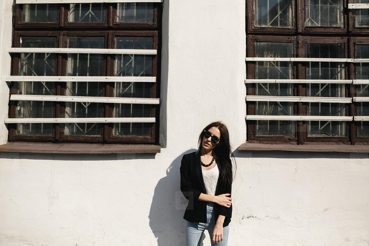 Beautiful model posing against the wall