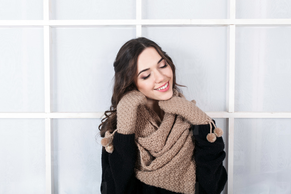 Cute girl in winter outfit posing for the camera  Christmas back