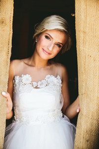 Smiling beautiful bride in doorway