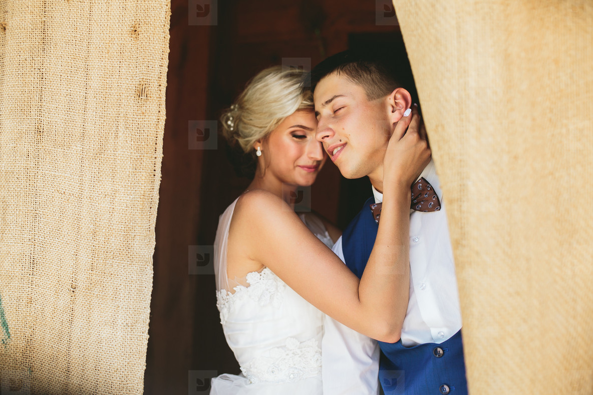 Beautiful wedding couple in doorway