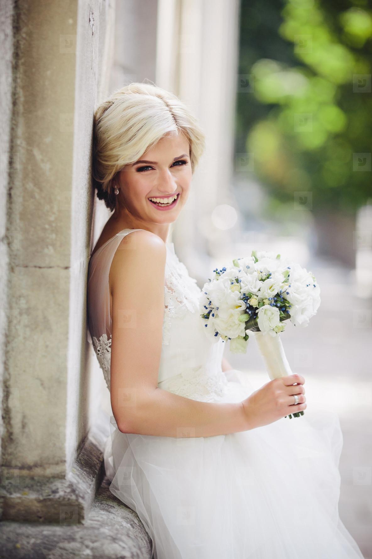 Young beautiful bride posing outdoors