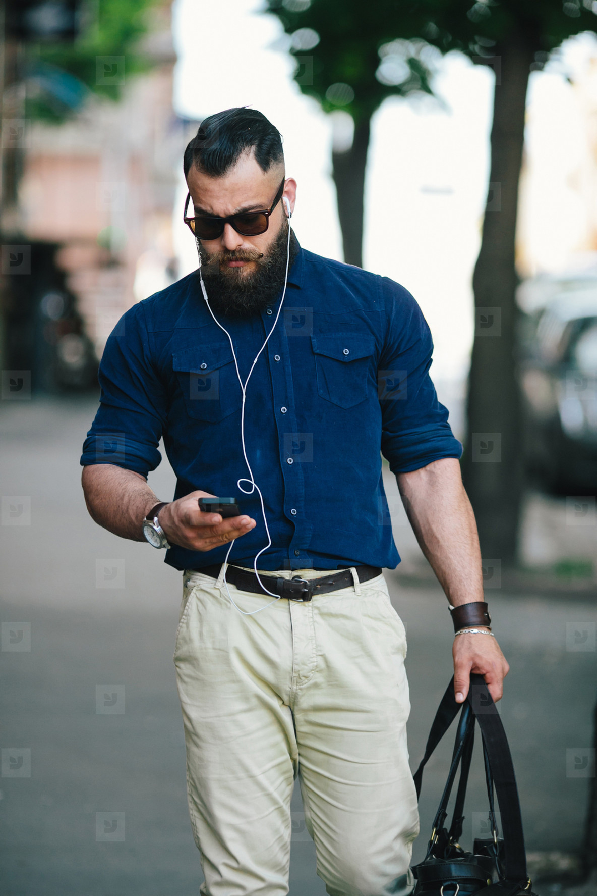 bearded man goes and listens to music