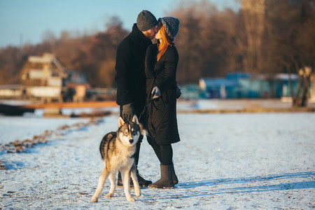 couple walking with a dog