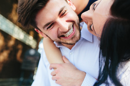 Woman Embracing Her Boyfriend From Behind