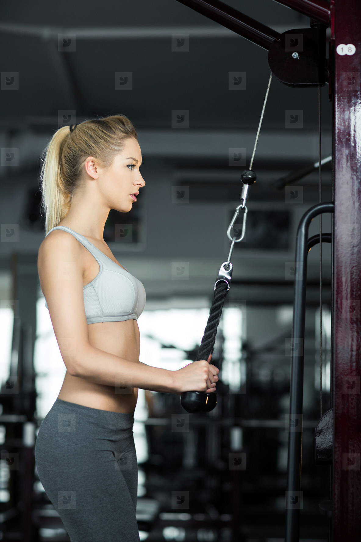 Girl doing exercise for the chest in the gym