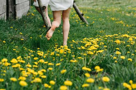 girls run in a grass
