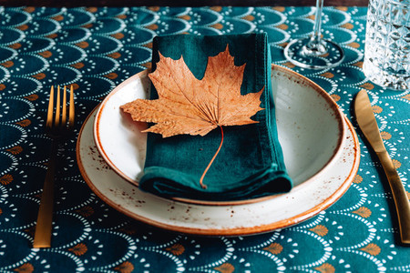 Festive table place for Thanksgiving dinner with Autumn decor