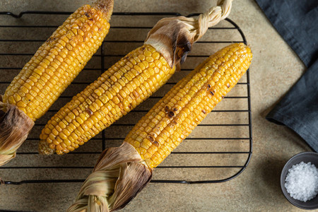 Roasted or grill corn cob with olive oil and salt on a rack  Tasty simple recipe  top view