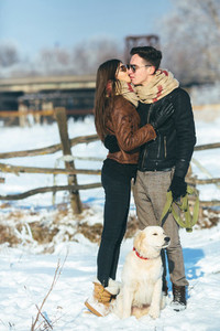 Young couple posing in winter park