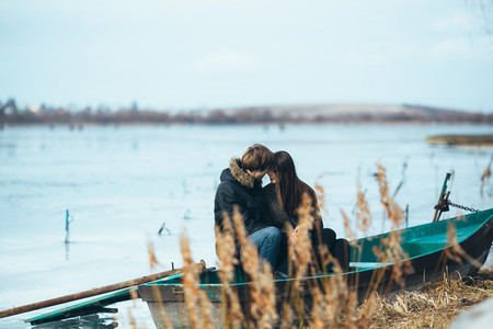 young beautiful couple on the ice of a frozen lake