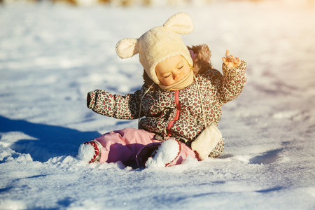 Little girl sitting in the snow