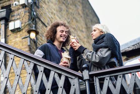 Happy couple eating Doner kebab  shawarma  in Camden Town