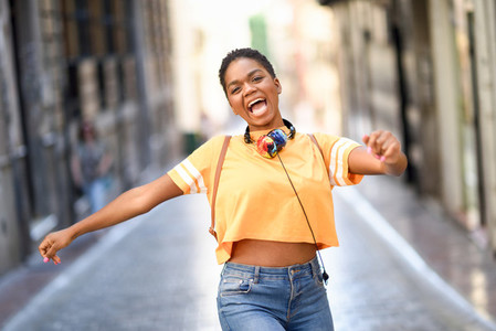 Young black woman is dancing on the street in Summer Girl traveling alone