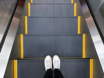 Selfie of feet in white sneakers shoes