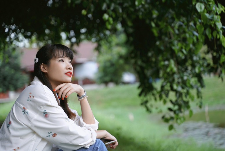 Young asian attractive woman in casual outfit thinking and relax