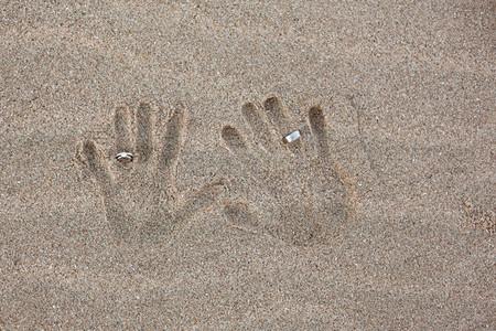 Wedding rings in sand