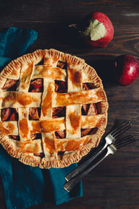 Top view on an apple pie on a wooden table Rustic moody food photography