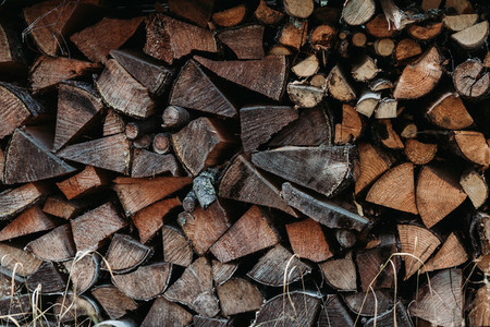 A large stack of firewood for the winter at outdoor  Rustic lifestyle background