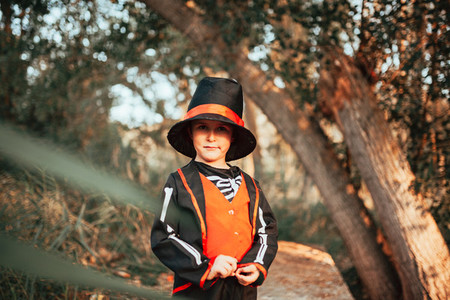 Boy disguised to halloween in the forest