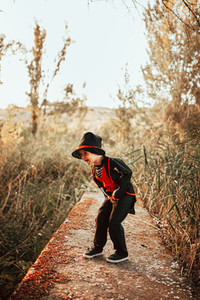 Boy laughing disguised to halloween in the forest