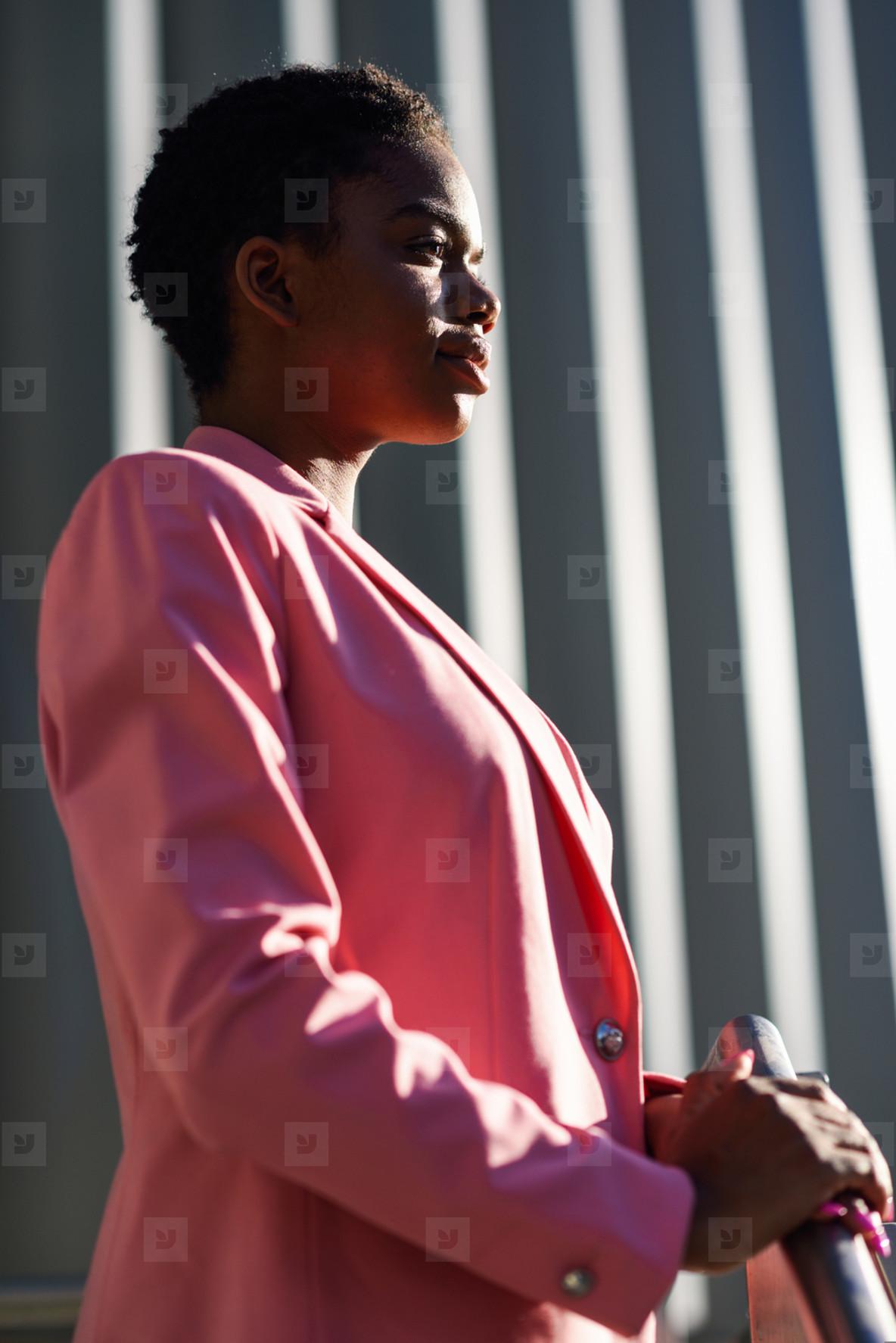 Black businesswoman standing near business office building