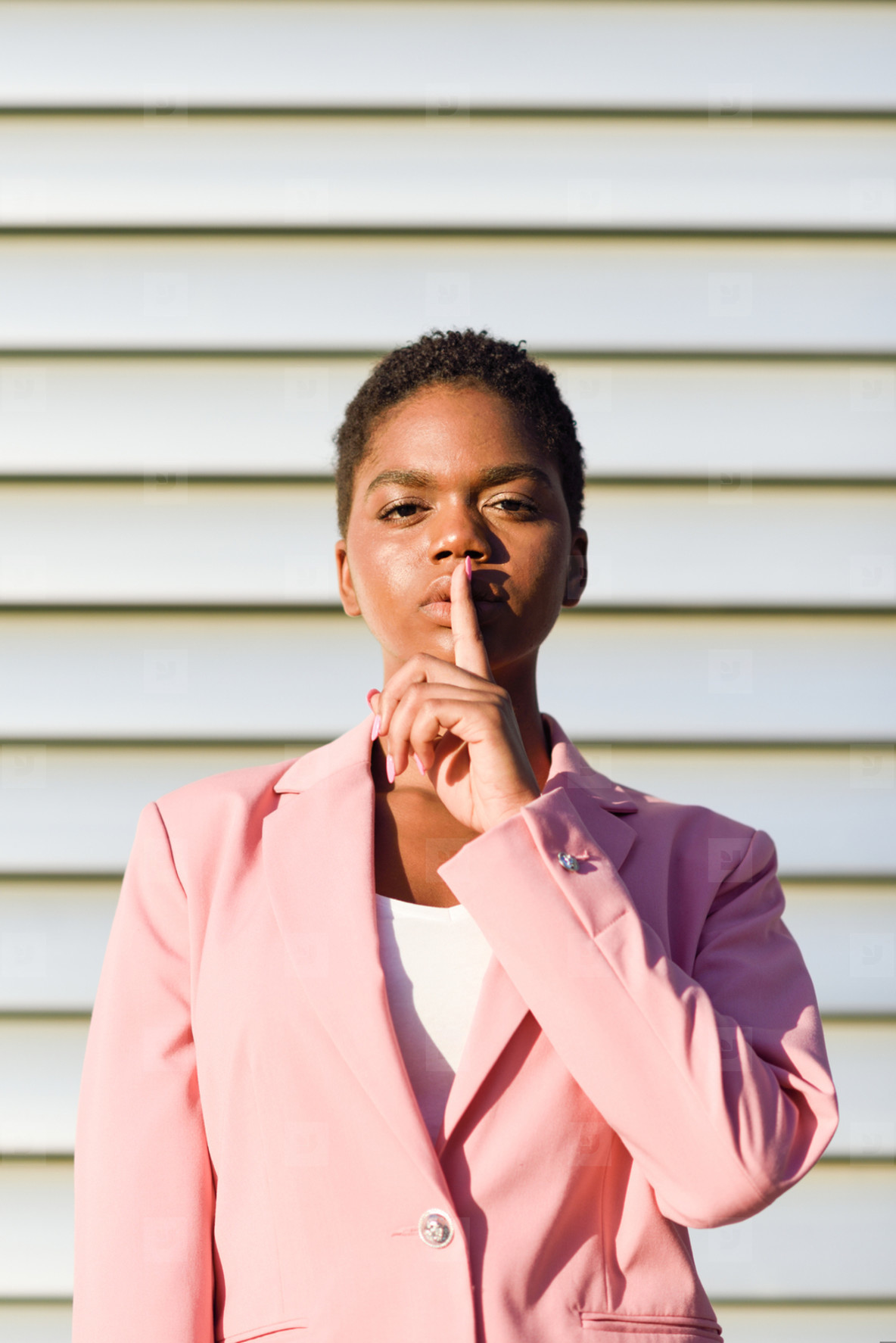 African American business woman doing silence gesture