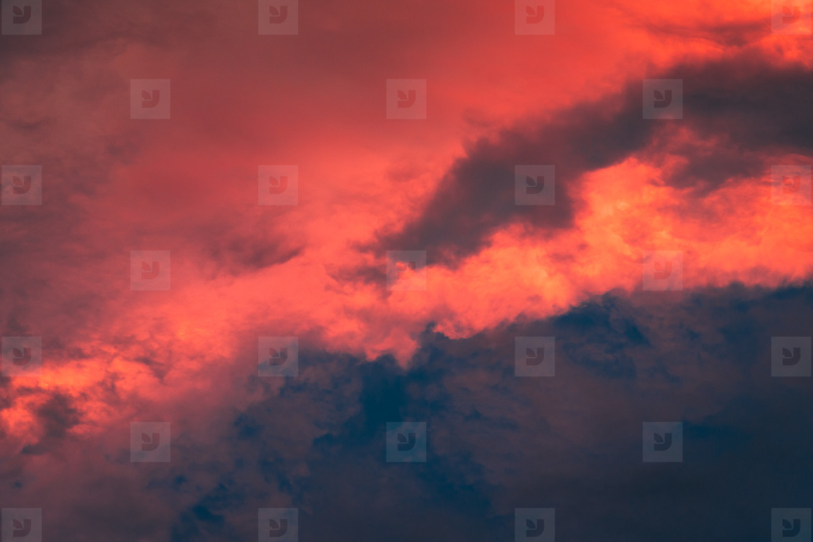 Dramatic moody stormy sky with red sunset light