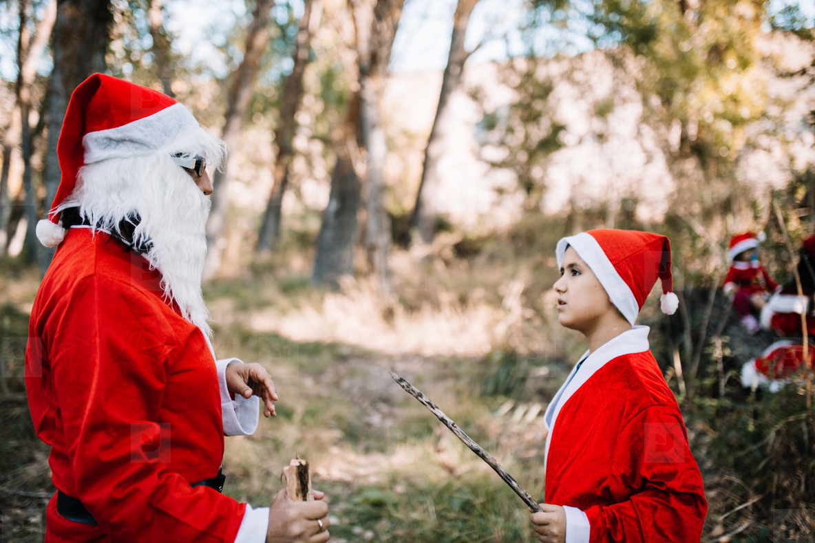 Mom and son disguised to christmas on the forest