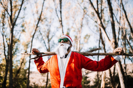 Santa claus with sunglasses observe the forest