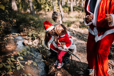 Mom and daughter disguised to christmas on the forest