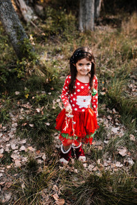Children disguised to christmas in the forest with their family