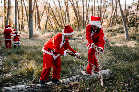 Mom and son disguised to christmas playing on the forest