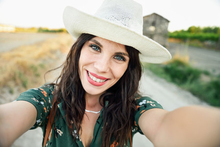 Hiker young woman taking a selfie photograph outdoors