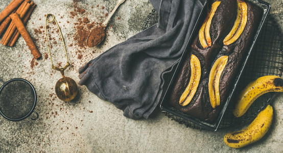 Chocolate banana bread cake in baking tin  top view
