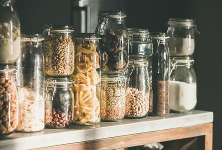 Rustic kitchen food storage arrangement over kitchen counter