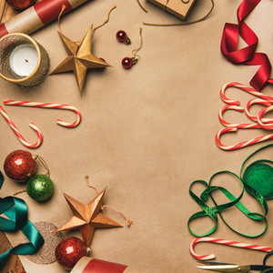 Christmas decorations and balls over wrapping paper  square crop