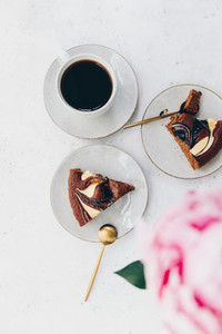 Cup of black coffee with chocolate cakes on white table The concept of breakfast flat lay top view