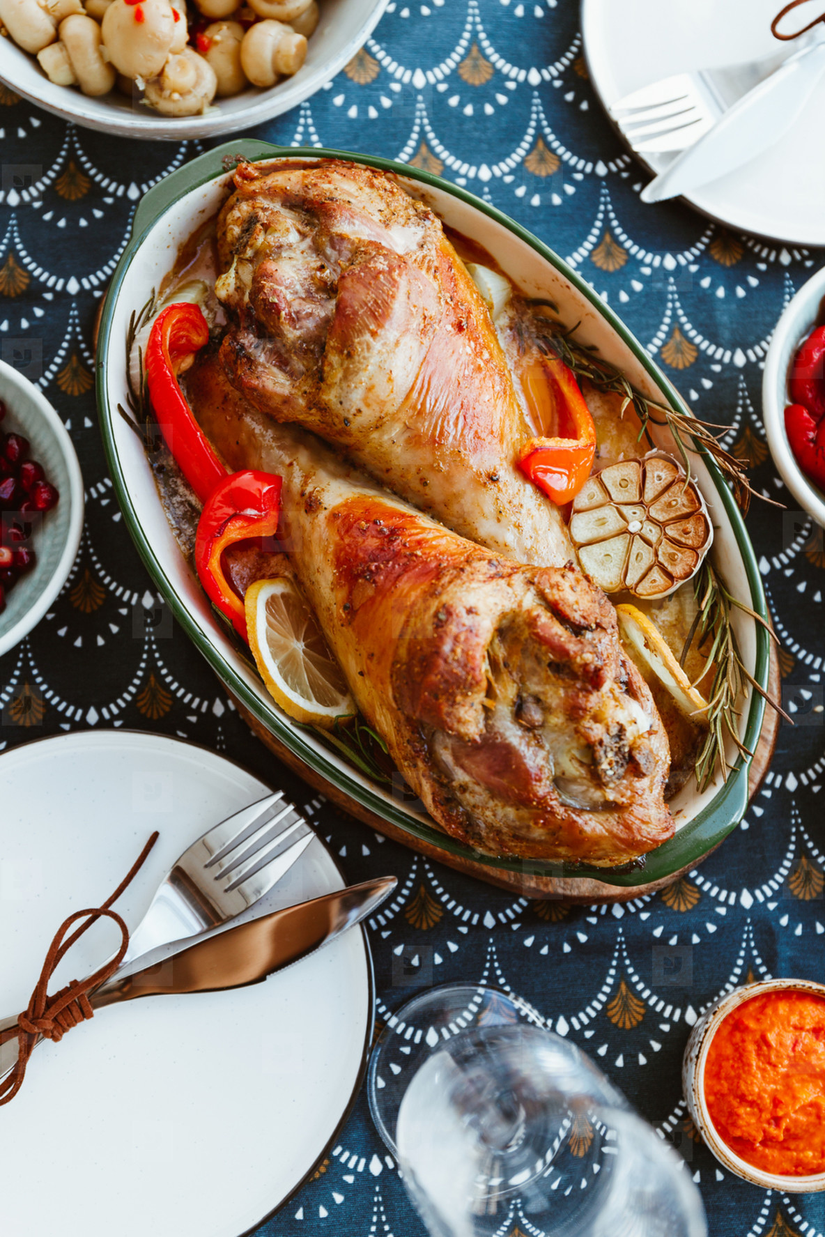 Festive dish for Thanksgiving  roasted turkey legs with vegetables on a table with appetizers  Top view  flat lay