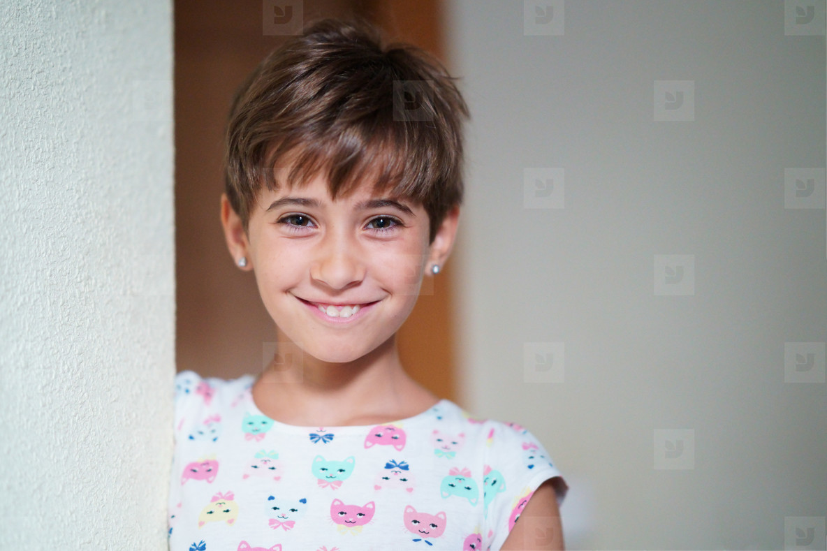 Funny little girl  eight years old  staring smiling to camera